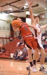 Norfork's Ethan Chapman attacks the basket against Lead Hill on Tuesday night.