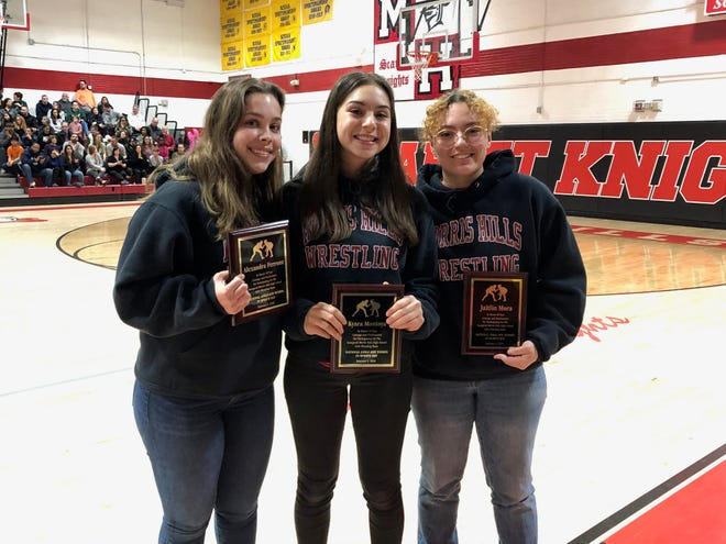 Alexandra Ferrone, Kyara Montoya and Jaitlin Mora are the inaugural Morris Hills girls wrestling team.