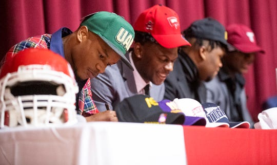 Lee players, including, Lee's Jamari Smith, left, and Kendrick Simpkins during signing day at the Lee campus in Montgomery, Ala., on Wednesday February 5, 2020.during signing day at the Lee campus in Montgomery, Ala., on Wednesday February 5, 2020.