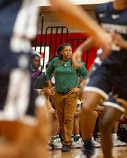 Jeff Davis head coach LaKenya Knight looks to her team during the first half of a game against Enterprise.