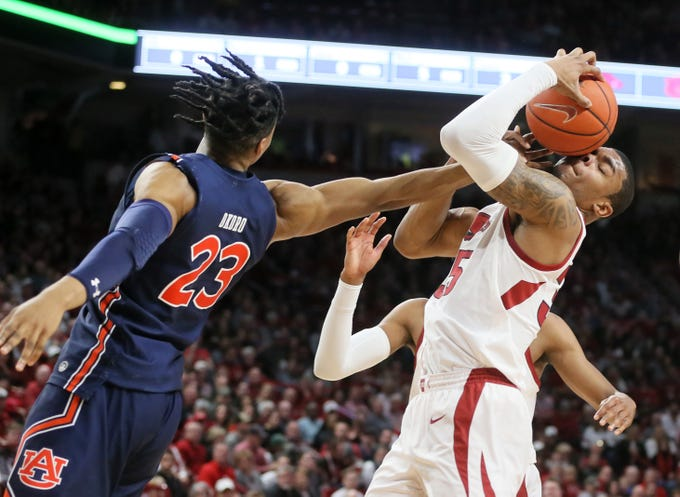 Feb 4, 2020; Fayetteville, Arkansas, USA; Arkansas Razorbacks forward Reggie Chaney (35) rebounds a ball against Auburn Tigers forward Isaac Okoro (23) during the first half at Bud Walton Arena. Mandatory Credit: Nelson Chenault-USA TODAY Sports