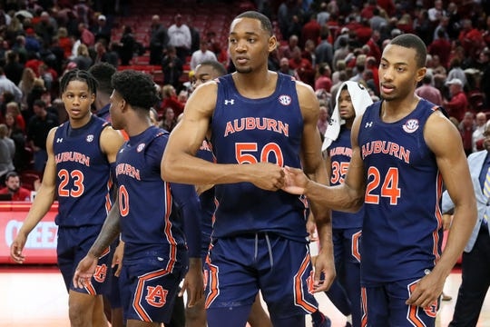 Auburn's Austin Wiley (50) and Anfernee McLemore (24) celebrate a win over Arkansas on Feb. 4, 2020, in Fayetteville, AR.