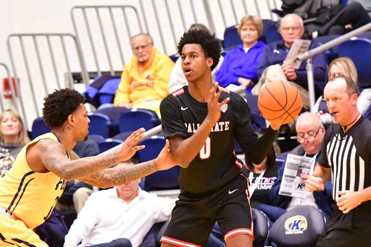 Ball State redshirt sophomore forward Miryne Thomas looks to pass during BSU's game Tuesday against Kent State. The Cardinals won the matchup.