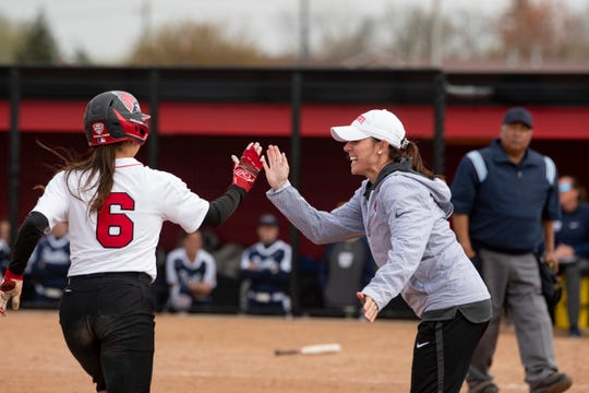 Ball State softball coach Megan Ciolli Bartlett celebrates with one of her players. Bartlett is now in her fifth year coaching the Cardinals.
