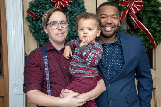 Michael Finch poses with his husband, Brandon Thomas, and their son, Ezra Finch-Thomas. The couple spends $1,000 monthly on their son's day care.