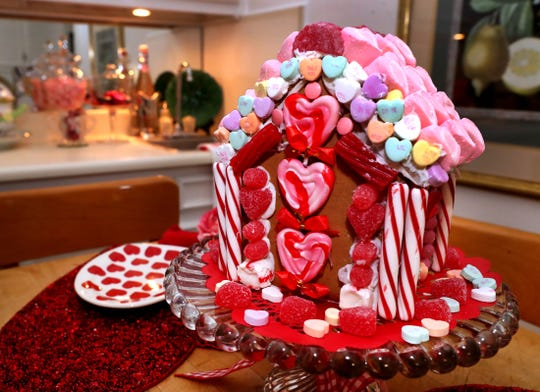 A Valentine-themed gingerbread home is on display in the breakfast room of the home of Ellen and Paul Willson on Tuesday, Feb. 4, 2020. The 1001 E. Main St. home is the site of this year's Charity Circle Ladies Valentine Luncheon.