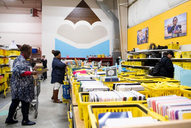 Teachers gather supplies for their classrooms at PENCIL on Tuesday, Feb. 4, 2020, in Nashville.