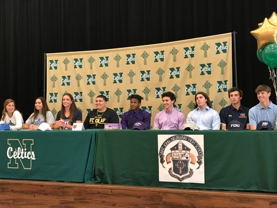 The nine student-athletes from St. John Neumann High School who signed with colleges on National Signing Day on Wednesday, Feb. 5, 2020, from left: Sophie Shrader, golf, West Florida; Chloe Pankita, swimming, South Dakota State; Maddy Burt, swimming, Arizona; Noah Annicelli, football, St. Olaf; Justin Mathieu, football, Sioux Falls; J.P. Raiger, football, Holy Cross; Andrew Saluan, football, Case Western; Nick Kythreotis, baseball, Fairleigh Dickinson; and Matthew Culbert, baseball, Emory.