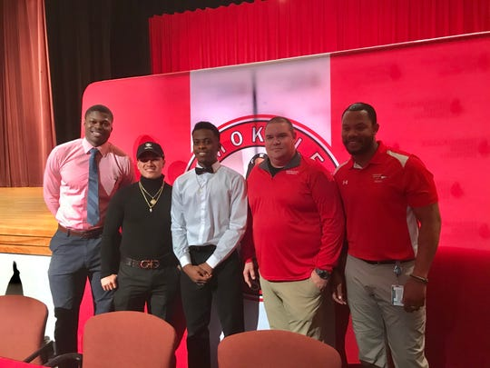 Immokalee's RJ Rosales and Pierre Percial stand with former members of the Immokalee coaching staff. From left are Rodelin Anthony, Rosales, Percial, Scott Freiburger and Louis Gachette.