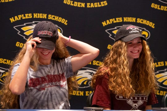 Kyleigh and Sophia Chickering prepare to sign their letters of intent during a National Signing Day ceremony, Wednesday, Feb. 5, 2020, at Naples High School.
