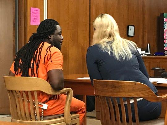 Kelisen Brewley, left, confers with his public defender, Jessica Kitzman, at Brewley's detention hearing in the stabbing death of Vanden Carter. 2/5/20