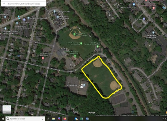 The football field east of the Wyckoff Library, which overlaps with two baseball diamonds, is proposed for installation of artificial turf.