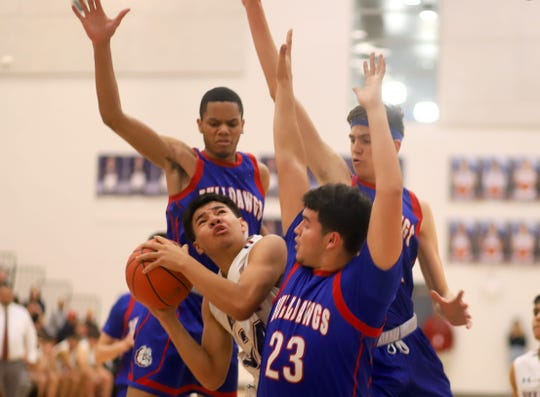 Junior Wildcat post Christian Pacheco held his own against a much taller Las Cruces front line. Pacheco led Deming High with 19 points in an 86-47 loss to the Bulldawgs Tuesday night.