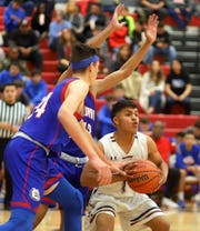 Junior Wildcat guard Jordan Caballero went inside among the tall Las Cruces High defenders on Tuesday. Caballero scored 17 points in an 86-47 loss to the Bulldawgs.