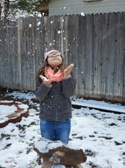 Danyelle Talamantes, of Las Cruces, throws snow in the air on Wednesday, Feb. 5, 2020.