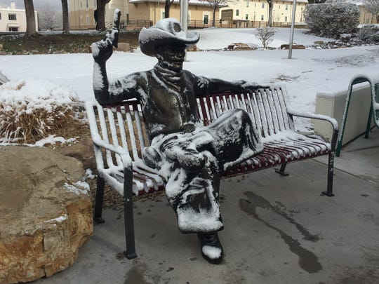 A statue of Pistol Pete on the New Mexico State University is dusted with snow on Wednesday, Feb. 5, 2020.