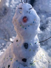 """Veronica Chavez built Olaf the snowman from the movie """"Frozen"""" in Las Cruces, New Mexico, on Feb. 5. The snow predicted for this week in in central Ohio just might be suitable for making snowmen."""