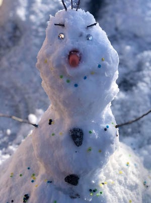 "Veronica Chavez built Olaf the snowman from the movie ""Frozen"" in Las Cruces, New Mexico, on Feb. 5. The snow predicted for this week in in central Ohio just might be suitable for making snowmen."