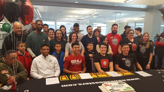Four Centennial football players signed to play college football on Wednesday. From left, Estevan Lowery (Eastern New Mexico), Jalen Mays (Southern Nazarene),  Jordan Mendoza (NMMI) and Aidan Trujillo (NMMI) will continue to play football.