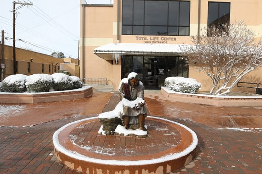 A snow covered statue of Jesus Christ greeted visitors to Artesia's First Baptist Church Feb. 5.