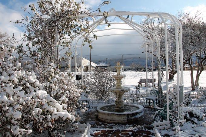 The Garden Center fountain in the snow.  Snow fell on Alamogordo as a result of two cold fronts coming across the area.