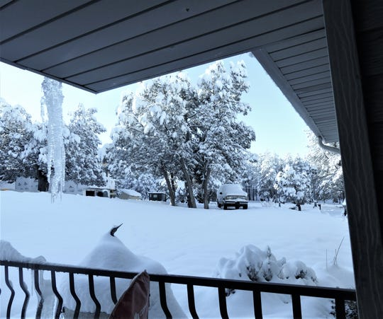 Roads and driveways are snowpacked on Nogal Place off Hull Road in Ruidoso.