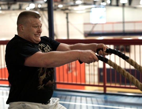 Jake Swirple pushes himself as he works some heavy ropes during a pre-wrestling warmup on Feb. 5, 2020.
