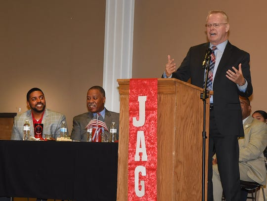 Richard Hartley, senior policy adviser for Gov. John Bel Edwards, speaks to Jobs For America's Graduates from four St. Landry Parish schools during a Tuesday Legislative Appreciation Day event at the Opelousas Civic Center. In the back ground are District 40 state Rep. Dustin Miller (left) and District 24 state Sen. Gerald Boudreaux.