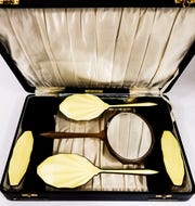 A ladies vanity set with guilloché backing.