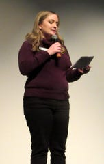 LunaFest chair Samantha Dewing welcomes a packed crowd at the Richards Center for the Arts at Palm Springs High School.