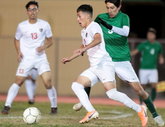 Desert Mirage's Erick Serrano gets around Coachella Valley's Diego Gonzalez before scoring a goal at Coachella Valley High School in Thermal, Calif., on Tuesday, February 4, 2020.