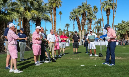 American Cancer Society Desert Golf Invitational participants listen to a pre-shotgun clinic on the driving range at Indian Wells Country Club from golf instructor and 2019 Desert Golf Celebration of Life honoree Bill Harmon.