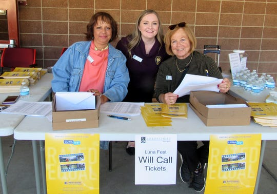 Soroptimist members Julia Henderson and Jane Turner worked the check-in with LunaFest chair Samantha Dewing.