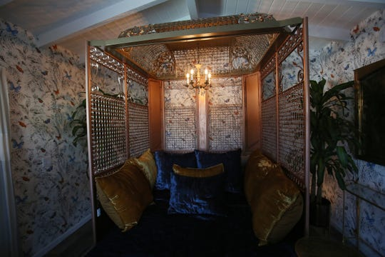 An ornate vintage elevator cage functions as a bed frame in a suite at Dive Palm Springs, an 11-room hotel that opened in late 2019. It's one of several small properties to debut during the 2019-2020 tourist season.