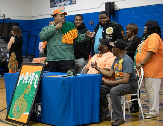 Family and friends surround Malcolm Moultrie as he announces his plans to attend Florida A&M during a National Signing Day event at Washington High School on Wednesday, Feb. 5, 2020.