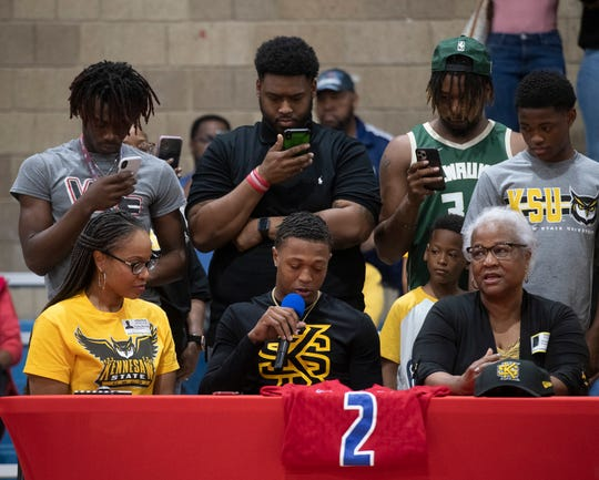 Family and friends surround Ladarius Clardy as he announces his plans to attend Kennesaw State during a National Signing Day event at Pine Forest High School on Wednesday, Feb. 5, 2020.