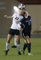 Pensacola High's Kate Vandiver (left) goes for a header during the Tigers' 3-2 win over Arnold in the District 1-4A final on Feb. 4, 2020 in Panama City.