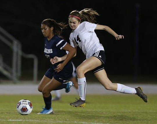 Pensacola High's Sophia Witkin (14) fights for the ball during the Tigers' 3-2 win over Arnold in the District 1-4A championship on Feb. 4, 2020 in Panama City.