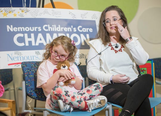 Ashley Baxley wipes away a tear Wednesday as she talks about her 10-year-old daughter Madi, who has a rare chromosomal disorder called Turner Syndrome.