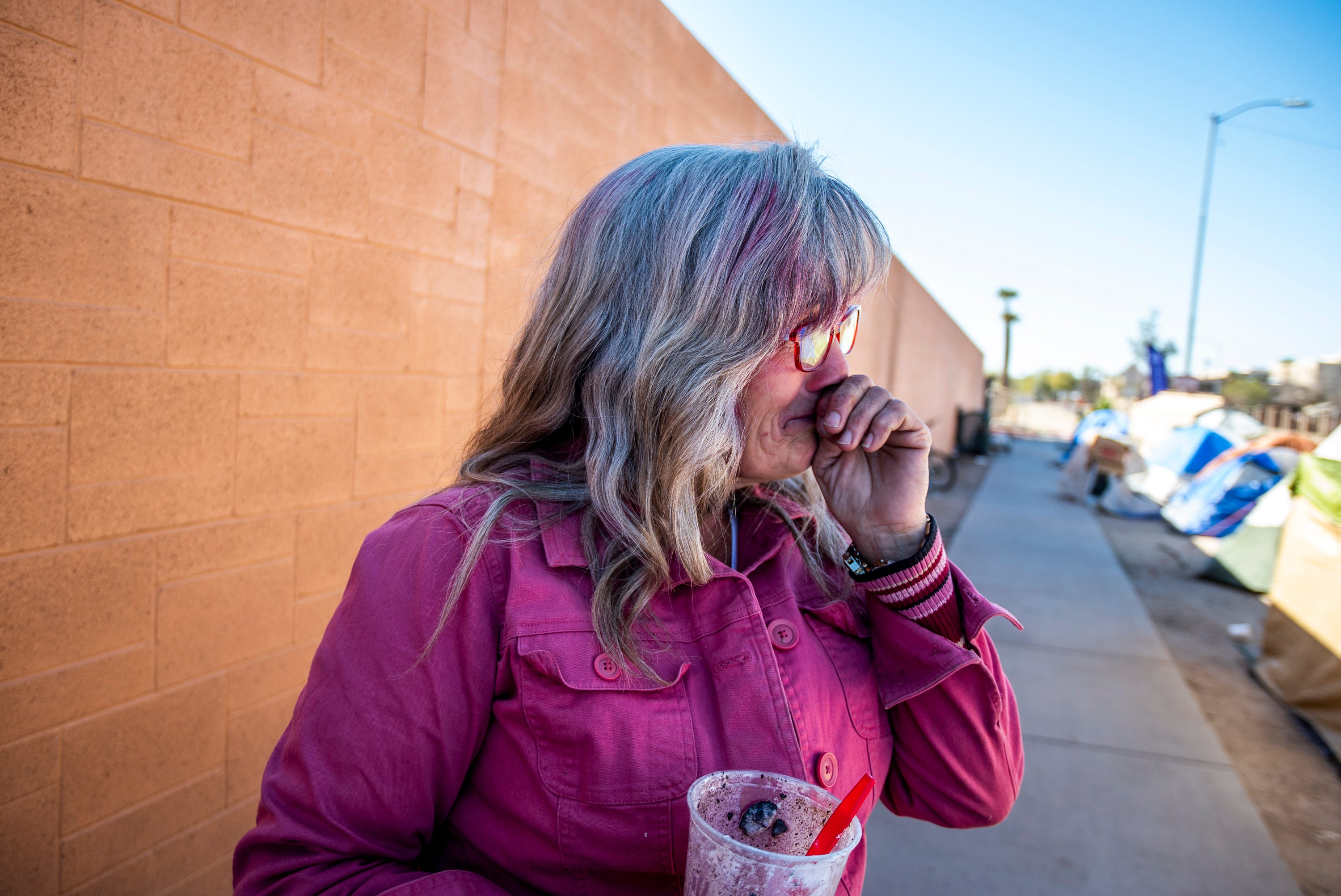 Darlene Carchedi gets emotional  on Feb. 4, 2020, after CASS employees help her with the upcoming encampment cleanup in Phoenix.