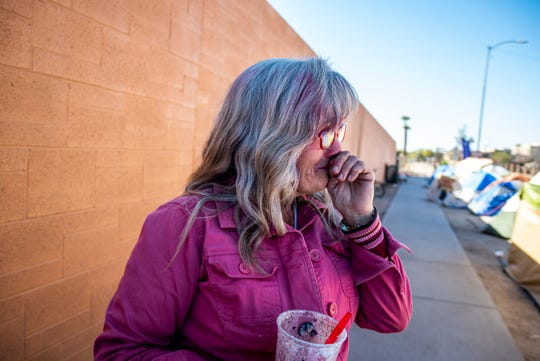 Darlene Carchedi gets emotional after CASS employees helped warn her and other people experiencing homelessness of the upcoming cleanup at an encampment of around 400 people near Central Arizona Shelter Services and other services in Phoenix on Tuesday, Feb. 4, 2020.