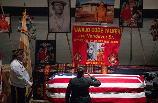 Shelby Vandever salutes the casket of her grandfather, Navajo Code Talker Joe Vandever Sr., during his funeral service on Feb. 5, 2020, at the El Morro Theatre in Gallup, New Mexico.