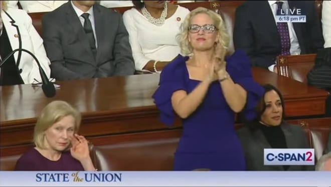 Sen. Kyrsten Sinema claps for President Donald Trump during the State of the Union on Feb. 4, 2020.