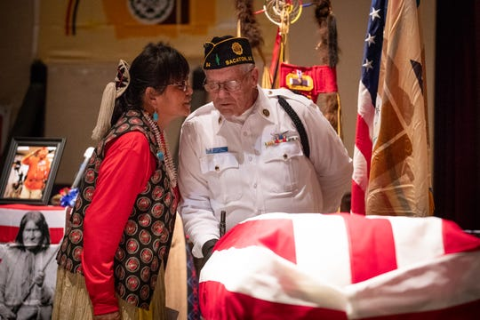Sheila Nez talks with a member of the Honor Guard before the funeral service for her dad, Navajo Code Talker Joe Vandever Sr., on Feb. 5, 2020, at the El Morro Theatre in Gallup, New Mexico.