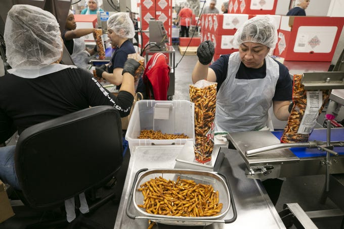 Margarita Ceceña packages pretzels at the Dot's Pretzels facility in Goodyear on Feb. 4, 2020.
