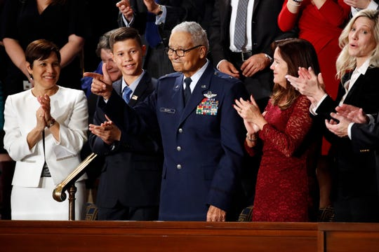 Tuskegee Airman Charles McGee, 100, and his great-grandson Iain Lanphier react as President Donald Trump delivers his State of the Union address to a joint session of Congress on Capitol Hill in Washington on Feb. 4, 2020.