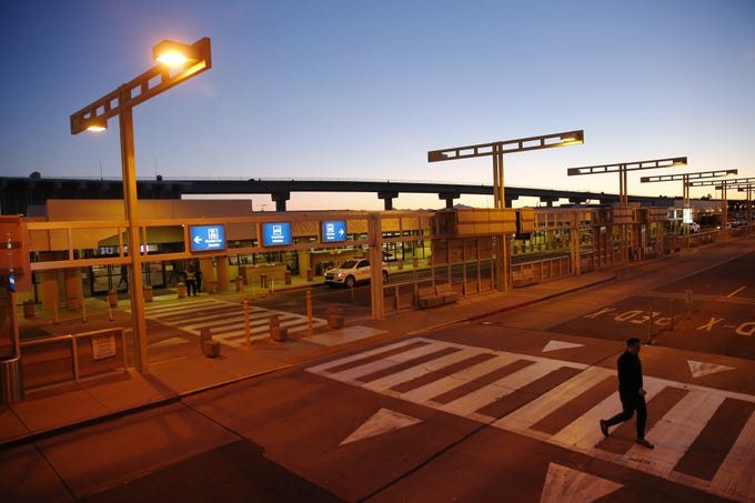 The sun sets over Sky Harbor Airport Terminal 2 on Feb. 4, 2020. The terminal will close after today.
