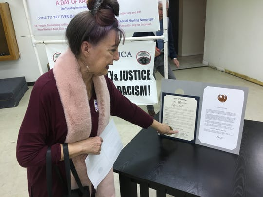 Joanne Scott Woods at Family of Faith Ministries i n Phoenix on Jan. 21, 2020, with the Day of Racial Healing proclamations she helped get passed.