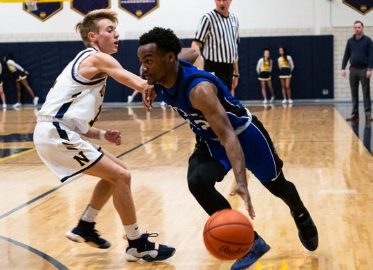 Northern's Carter Stoner (left) defends against Warren Woods Tower's Hasson Posey during their game Tuesday, Feb. 4, 2020, at Port Huron Northern High School.