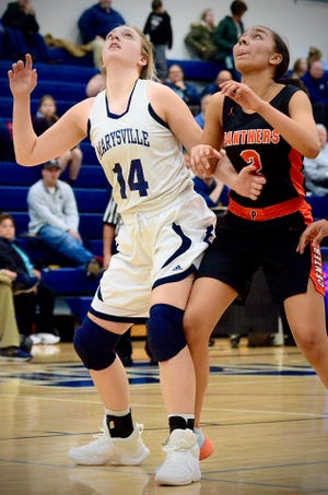 Marysville's Natalie Husson looks for a rebound against Center Line during a Macomb Area Conference-Gold girls basketball game on Tuesday, Feb. 4, at Marysville.